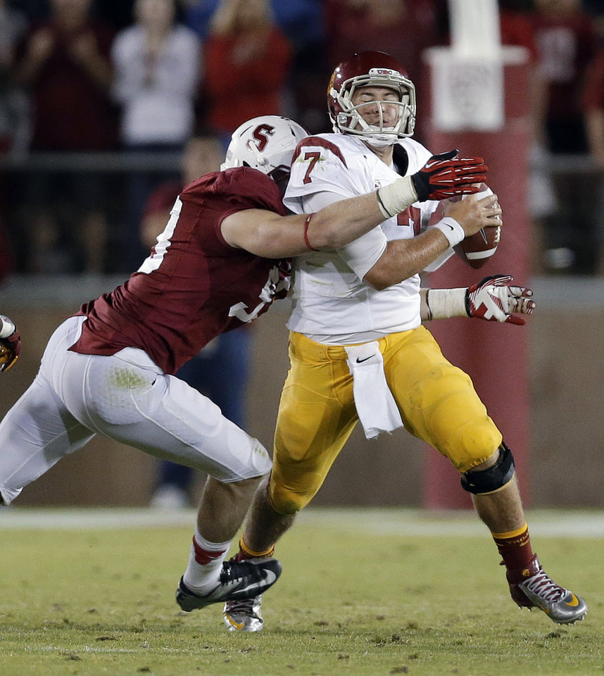Photo -   Southern California quarterback Matt Barkley, right, is sacked by Stanford linebacker Trent Murphy during the second half of an NCAA college football game in Stanford, Calif., Saturday, Sept. 15, 2012. Stanford won 21-14. (AP Photo/Marcio Jose Sanchez)