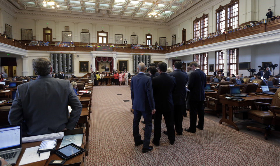 Photo - Texas House members debate during the second reading of HB 2, legislation that will restrict abortion rights, on the Texas House floor,Tuesday, July 9, 2013, in Austin, Texas. The Texas House is expected to vote on the bill Tuesday. (AP Photo/Eric Gay)