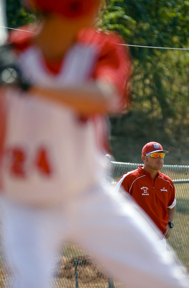 Photo - Former Major League Baseball player and current head coach of the Binger-Oney High School baseball team Reggie Willits looks on during his team's at bat on Thursday, Sept. 20, 2012, in Binger, Okla. Photo by Chris Landsberger, The Oklahoman