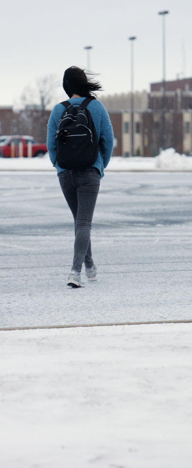 Photo - A student walks in the wind and snow on the University of Central Oklahoma campus in Edmond Monday, Feb. 13, 2012. Because of the weather Monday UCO was closed and classes delayed until 10am. Photo by Paul B. Southerland, The Oklahoman