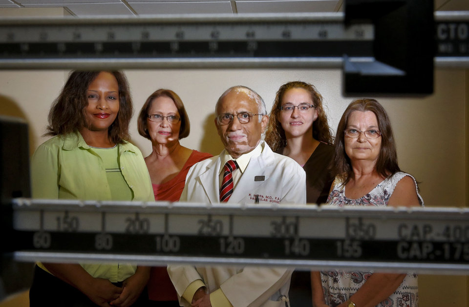 Photo - LaWanna Porter, June Graham, Dr. Kautilya A Mehta, Jessica Mayberry and Bea Eberly, from left, pose for a photo in the Weight Control Clinic at St. Anthony Hospital in Oklahoma City. PHOTO BY CHRIS LANDSBERGER, THE OKLAHOMAN