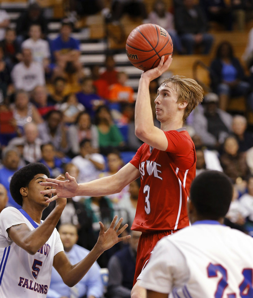 Photo - Howe senior Nick Smallwood launches a shot over Millwood defenders Ashford Golden, left, and Deaundry Lewis in the Class 2A boys basketball quarterfinal game between Millwood and Howe at Oklahoma City University  on Thursday night, Mar. 13, 2014. Photo by Jim Beckel, The Oklahoman