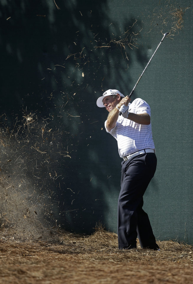 Photo - Lee Westwood of England, hits onto the ninth green during the first round of The Players championship golf tournament at TPC Sawgrass, Thursday, May 8, 2014 in Ponte Vedra Beach, Fla. (AP Photo/Gerald Herbert)