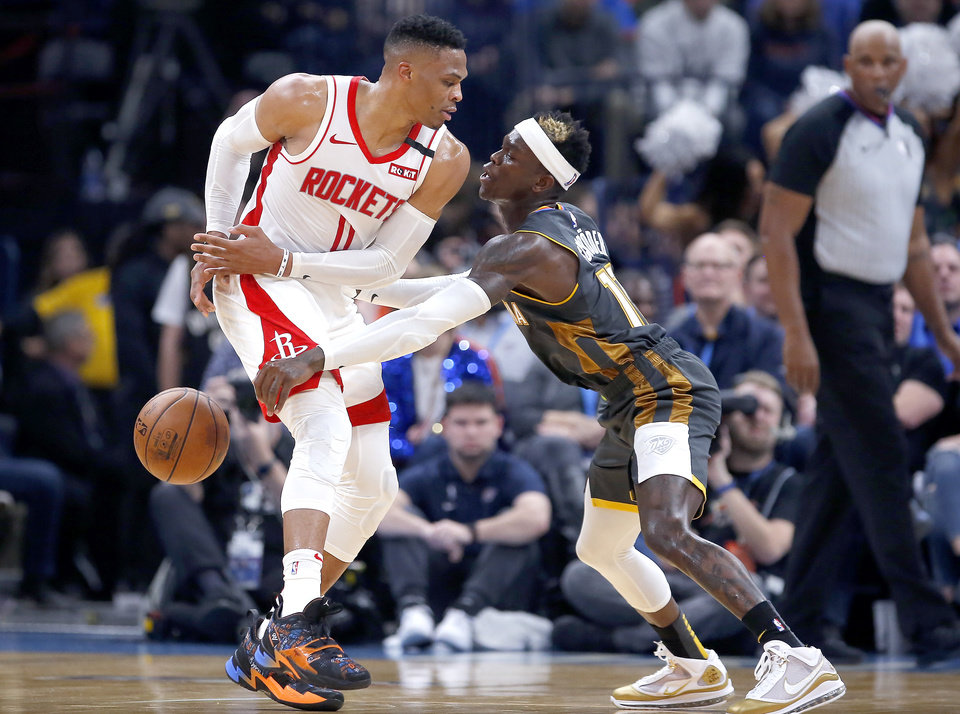 Photo - Oklahoma City's Dennis Schroder (17) defends against Houston's Russell Westbrook (0) during the NBA basketball game between the Oklahoma City Thunder and the Houston Rockets at the Chesapeake Energy Arena in Oklahoma City,  Thursday, Jan. 9, 2020.  [Sarah Phipps/The Oklahoman]