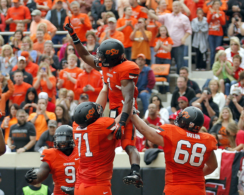 Photo - Oklahoma State's Kye Staley (9), Parker Graham (71) and Lane Taylor (68) celebrate a touchdown with Joseph Randle (1) during a college football game between Oklahoma State University (OSU) and the University of Louisiana-Lafayette (ULL) at Boone Pickens Stadium in Stillwater, Okla., Saturday, Sept. 15, 2012. Photo by Sarah Phipps, The Oklahoman