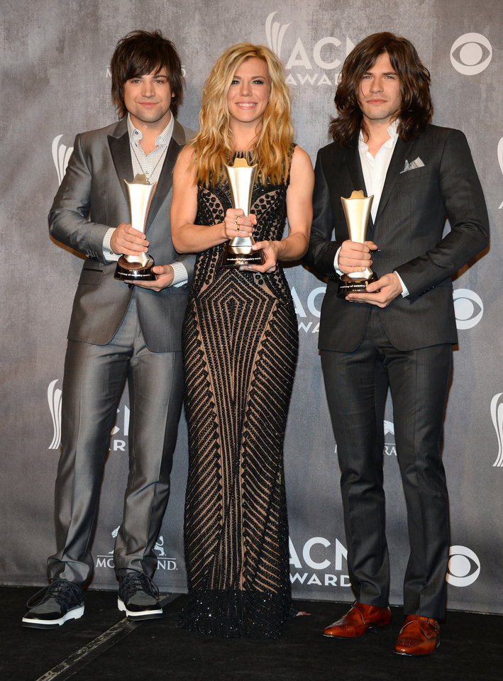 Photo - Dave Haywood, and from left, Hillary Scott and Charles Kelley, of the musical group Lady Antebellum, pose in the press room with the award for vocal group of the year at the 49th annual Academy of Country Music Awards at the MGM Grand Garden Arena on Sunday, April 6, 2014, in Las Vegas. (Photo by Al Powers/Powers Imagery/Invision/AP)