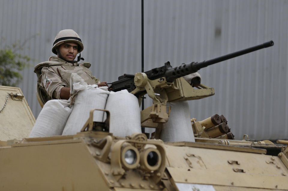Photo - An Egyptian Army soldier takes his position on top of an armored vehicle while guarding an entrance to Tahrir Square, in Cairo, Egypt, Friday, Aug. 16, 2013. Egypt is bracing for more violence after the Muslim Brotherhood called for nationwide marches after Friday prayers and a