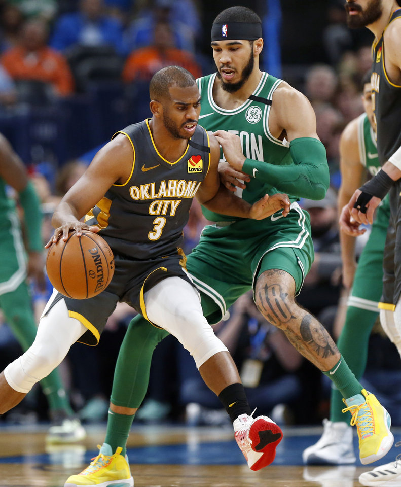 Photo - Oklahoma City's Chris Paul (3) dribbles as Boston's Jayson Tatum (0) defends in the second quarter during an NBA basketball game between the Oklahoma City Thunder and the Boston Celtics at Chesapeake Energy Arena in Oklahoma City, Sunday, Feb. 9, 2020. [Nate Billings/The Oklahoman]