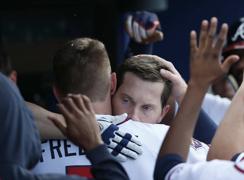 Photo - Atlanta Braves' Chris Johnson, right,  gets a hug from Freddie Freeman after hitting a two-run home run in the second inning of a baseball game against the Miami Marlins  Thursday, July 24, 2014 in Atlanta. (AP Photo)
