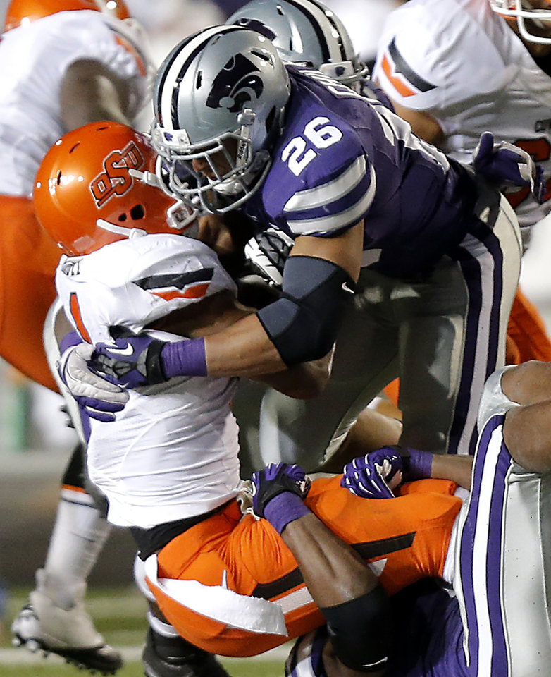 Photo - Kansas State's Jarell Childs (26) stops Oklahoma State's Joseph Randle (1) during the college football game between the Oklahoma State University Cowboys (OSU) and the Kansas State University Wildcats (KSU) at Bill Snyder Family Football Stadium on Saturday, Nov. 1, 2012, in Manhattan, Kan. Photo by Chris Landsberger, The Oklahoman