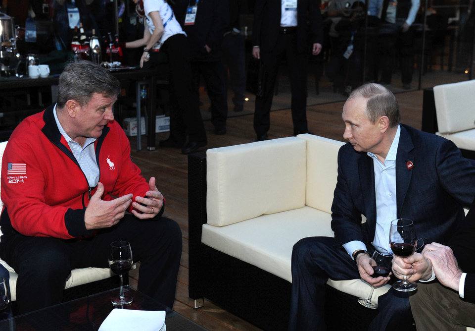 Photo - Russian President Vladimir Putin, right, speaks with Head of the United States National Olympic Committee Scott Blackman while visiting USA House during the 2014 Winter Olympics, Friday, Feb. 14, 2014 in Sochi, Russia.  (AP Photo / RIA-Novosti, Mikhail Klimentyev, Presidential Press Service)