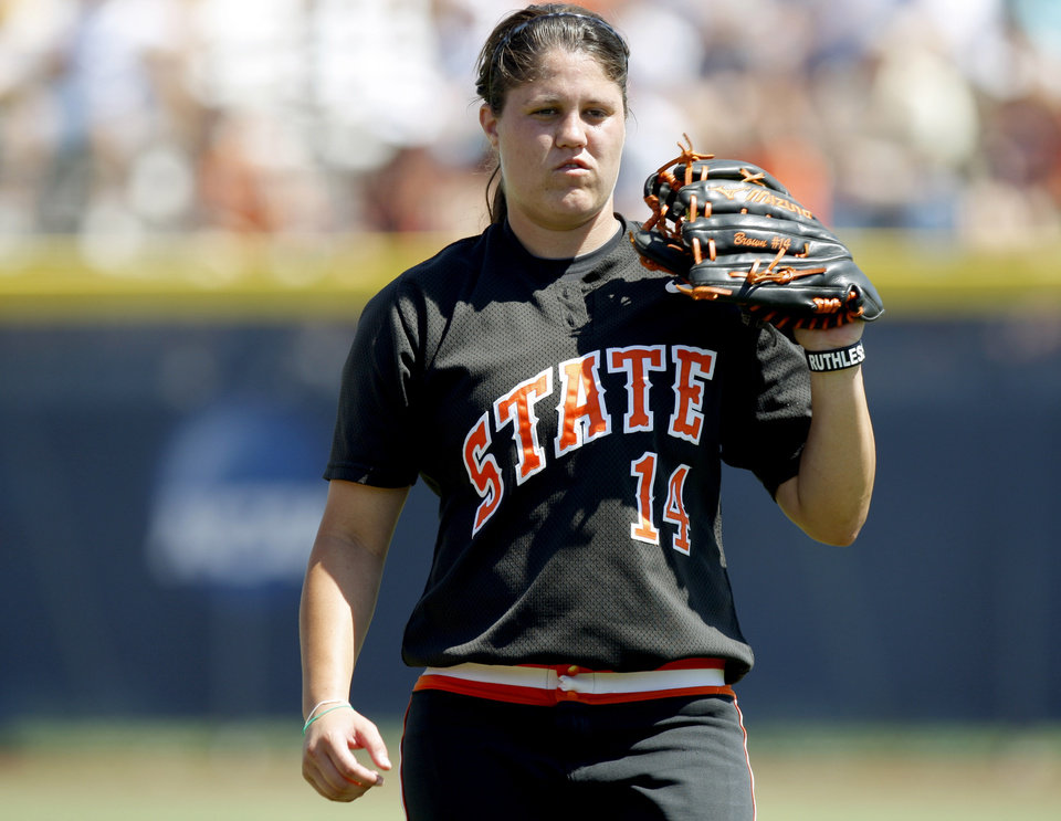 Photo - Oklahoma State's Tamara Brown (14) stands between innings during a Women's College World Series softball game between Oklahoma State University and California at ASA Hall of Fame Stadium in Oklahoma City, Saturday, June 4, 2011. Photo by Bryan Terry, The Oklahoman ORG XMIT: KOD