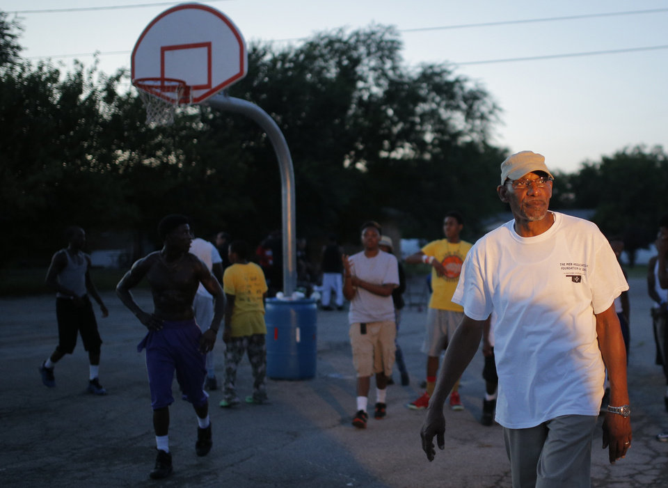 Photo - David Sims coach youth during midnight basketball at Christ Temple Community Church in Oklahoma City, Friday, Aug. 1, 2014. Photo by Sarah Phipps, The Oklahoman