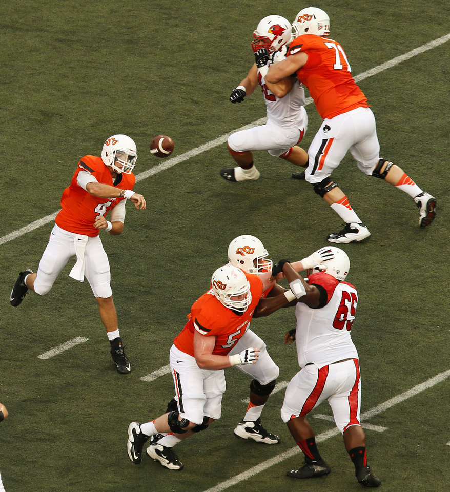 Photo - Oklahoma State's J.W. Walsh (4) passes during a college football game between the Oklahoma State University Cowboys (OSU) and the Lamar University Cardinals at Boone Pickens Stadium in Stillwater, Okla., Saturday, Sept. 14, 2013. Photo by Nate Billings, The Oklahoman