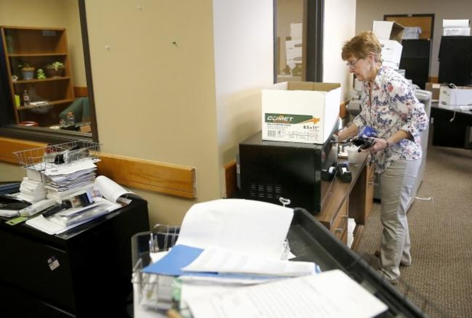Photo -  Paula Hurt, warrant records supervisor, unpacks at the Oklahoma County Sheriff's Office at the Krowse Building near Northeast 36th and North Martin Luther King Avenue in Oklahoma City, Wednesday, June 17, 2020. [Sarah Phipps/The Oklahoman]