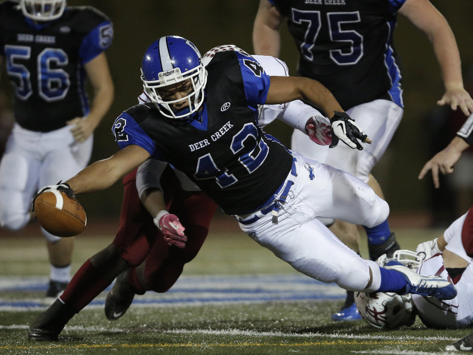 Deer Creek\'s Alec James (42) goes down during a high school football game between Deer Creek and Ardmore at Deer Creek Stadium in Edmond, Okla., Friday, Nov. 9, 2012. Photo by Garett Fisbeck, The Oklahoman