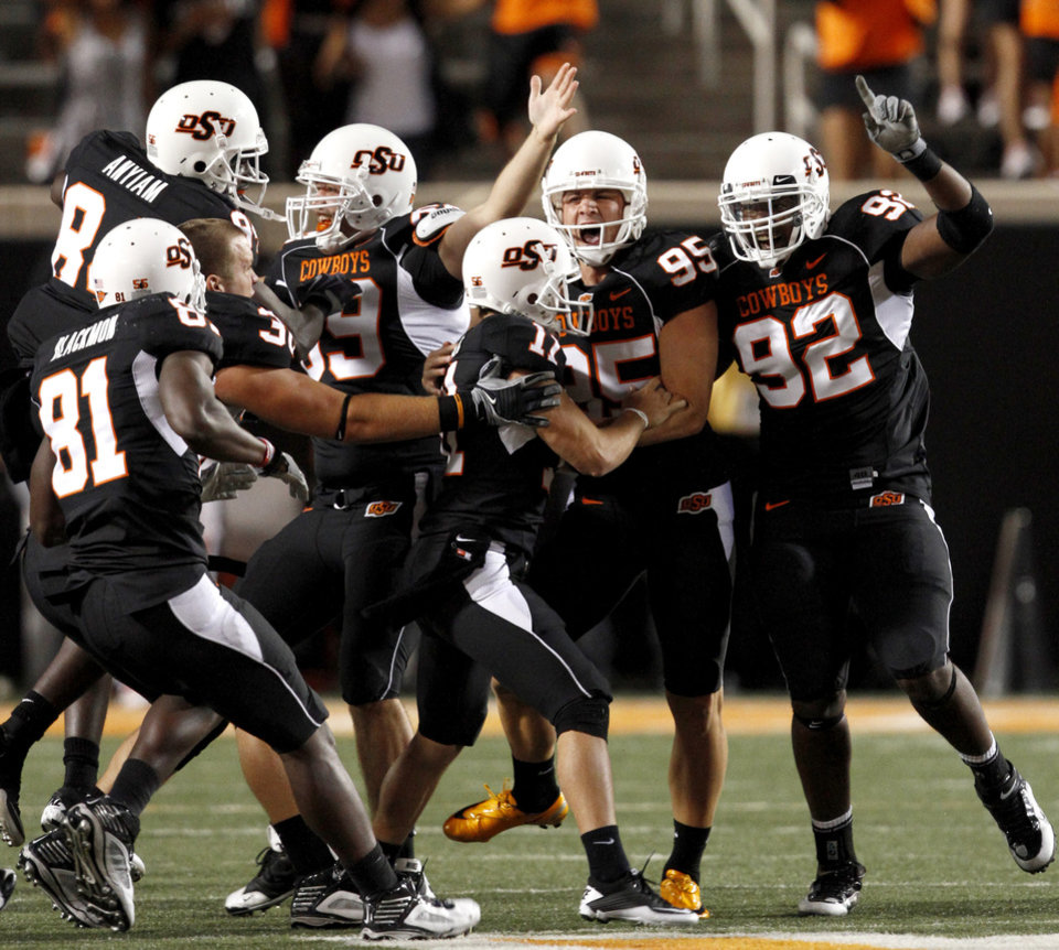 Photo - OSU's Dan Bailey (95) celebrates after making the game-winning field goal during the college football game between Texas A&M University and Oklahoma State University (OSU) at Boone Pickens Stadium in Stillwater, Okla., Thursday, Sept. 30, 2010. Photo by Bryan Terry, The Oklahoman