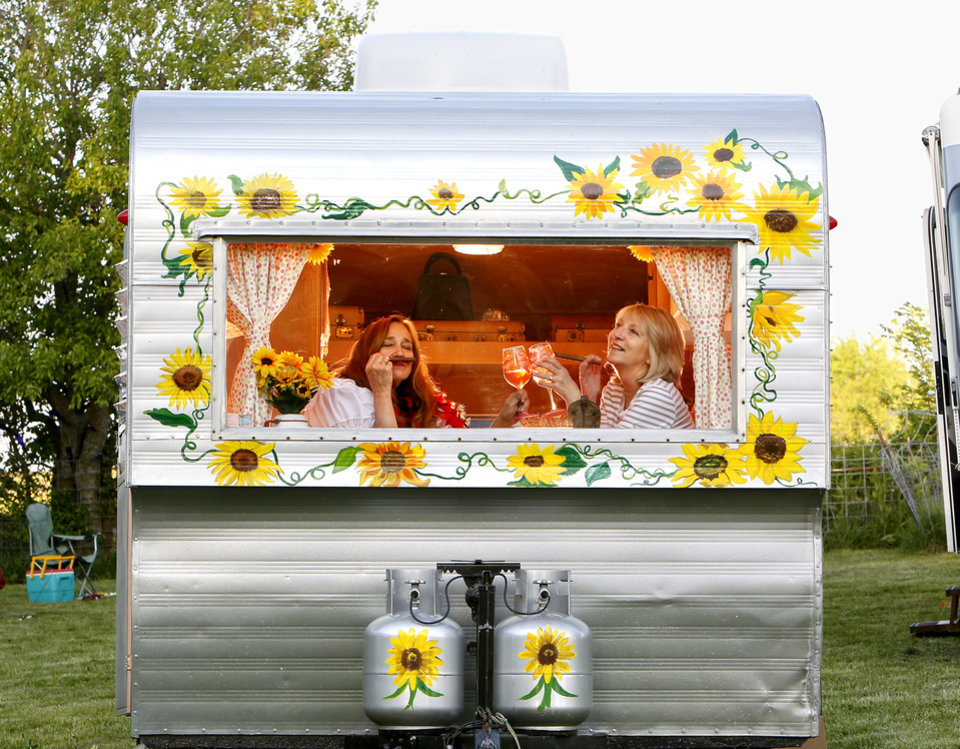 Members of Sisters on the Fly, Elaine Toland, left, of Tecumseh, Kan., and Lori Thompson of Leawood, Kan., pose for a photo in Thompson's Kansas-themed camper in Louisburg. Kansas, on April 21, 2012. Sisters on the Fly is a national group of camping enthusiasts founded by two actual sisters who love fly-fishing in Montana. (Jill Toyoshiba/Kansas City Star/MCT)