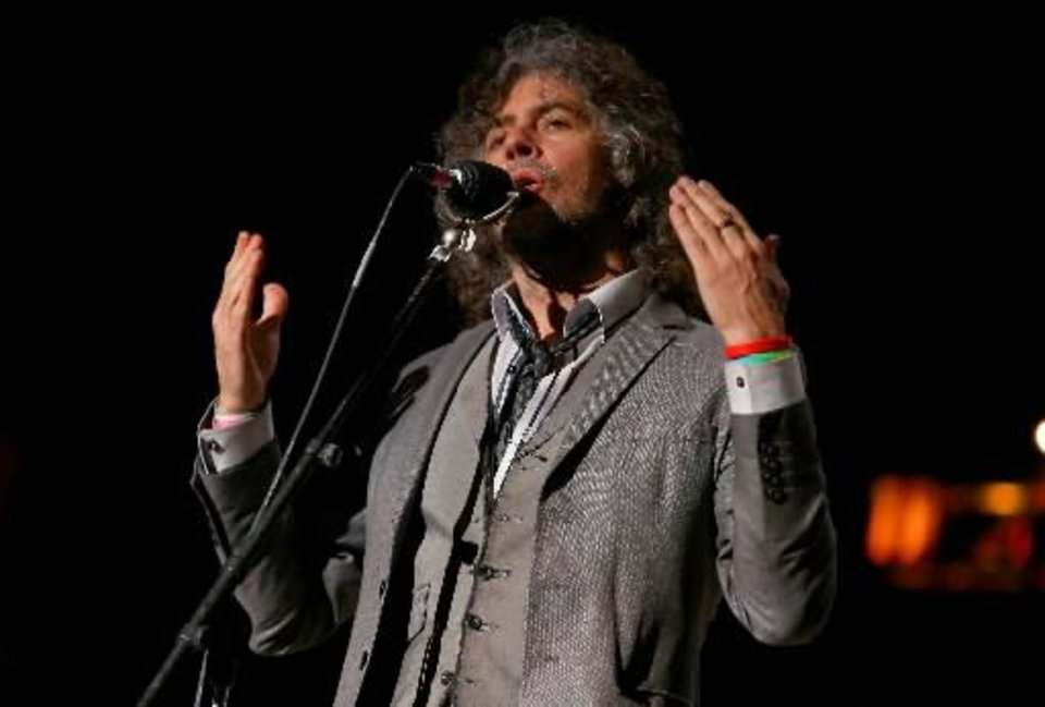 Photo -  Wayne Coyne of The Flaming Lips performs at the Bridge School Benefit Concert at the Shoreline Amphitheatre on Saturday, Oct. 20, 2012, in Mountain View, Calif. (AP)