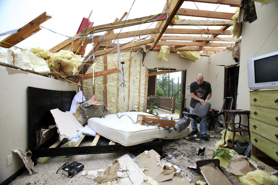 Photo - David Potts helps salvage belongings in the home of his friends, Miles and Rachel Maynor Tuesday morning, May 11, 2010.  The home was destroyed in Monday night's tornado.  The home is at 8801 S. Hiwassee in Oklahoma City.  Photo by Jim Beckel, The Oklahoman