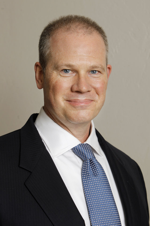 Photo -  Gregg Cheshier An assurance partner in PwC's energy practice   PAUL B. SOUTHERLAND -