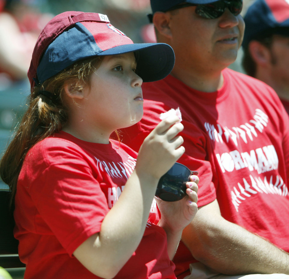 Photo - OKLAHOMA CITY REDHAWKS / MINOR LEAGUE BASEBALL / KIDS DAY / CHILD / CHILDREN: Eight-year-old Melanie Vasquez and her father Servando Vasques enjoy Kids Day at the Chickasaw Bricktown Ballpark in Oklahoma City, OK, Tuesday, May 14, 2013,  By Paul Hellstern, The Oklahoman