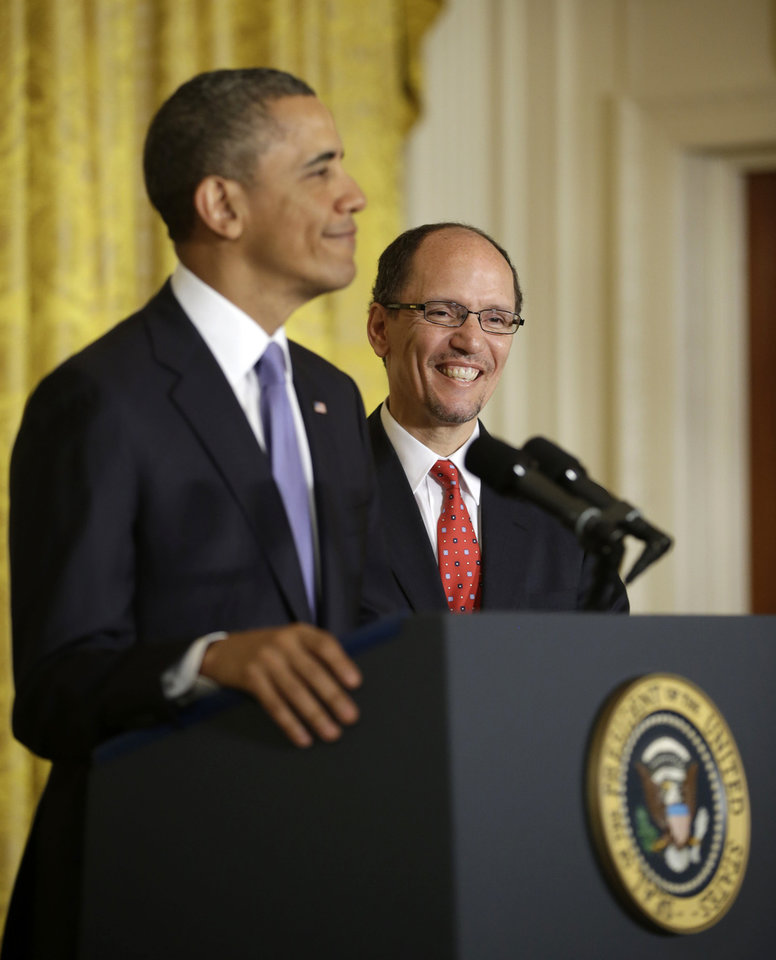 Thomas E. Perez smiles at right as President Barack Obama announces he will nominate Perez for Labor Secretary, Monday, March 18, 2013, in the East Room of the White House in Washington. (AP Photo/Pablo Martinez Monsivais)