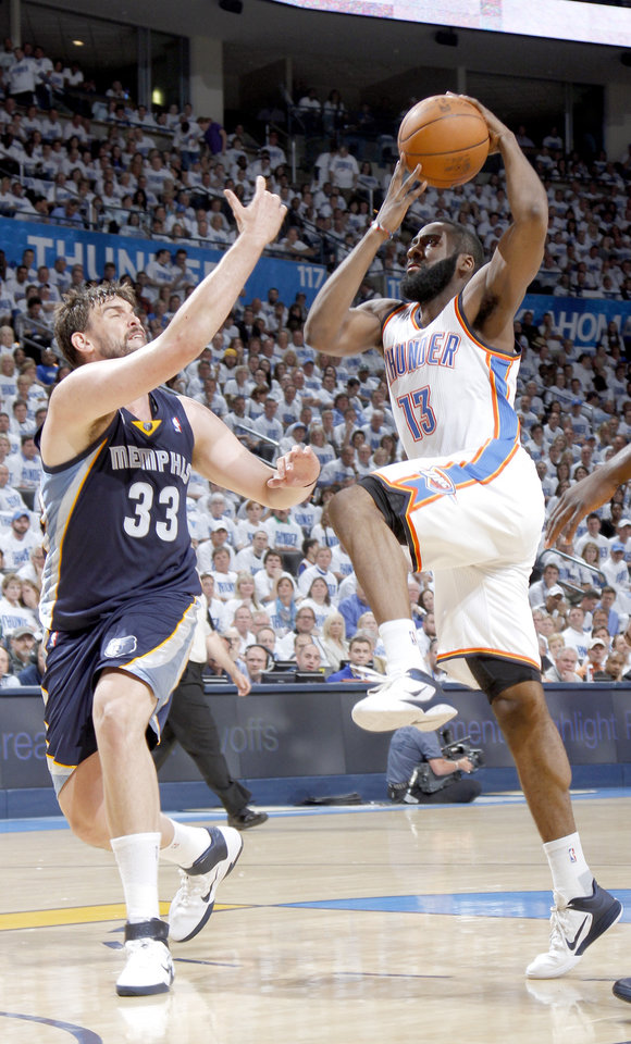 Photo - Oklahoma City's James Harden (13) drives for a lay up as Marc Gasol (33) of Memphis defends during game five of the Western Conference semifinals between the Memphis Grizzlies and the Oklahoma City Thunder in the NBA basketball playoffs at Oklahoma City Arena in Oklahoma City, Wednesday, May 11, 2011. Photo by Bryan Terry, The Oklahoman