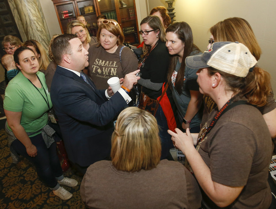 Photo - Rep. Matt Meredith, D-Tahlequah, talks to teachers from Tahlequah outside the House chamber on the fourth floor during the third day of a walkout by Oklahoma teachers at the state Capitol in Oklahoma City, Wednesday, April 4, 2018. Photo by Nate Billings, The Oklahoman