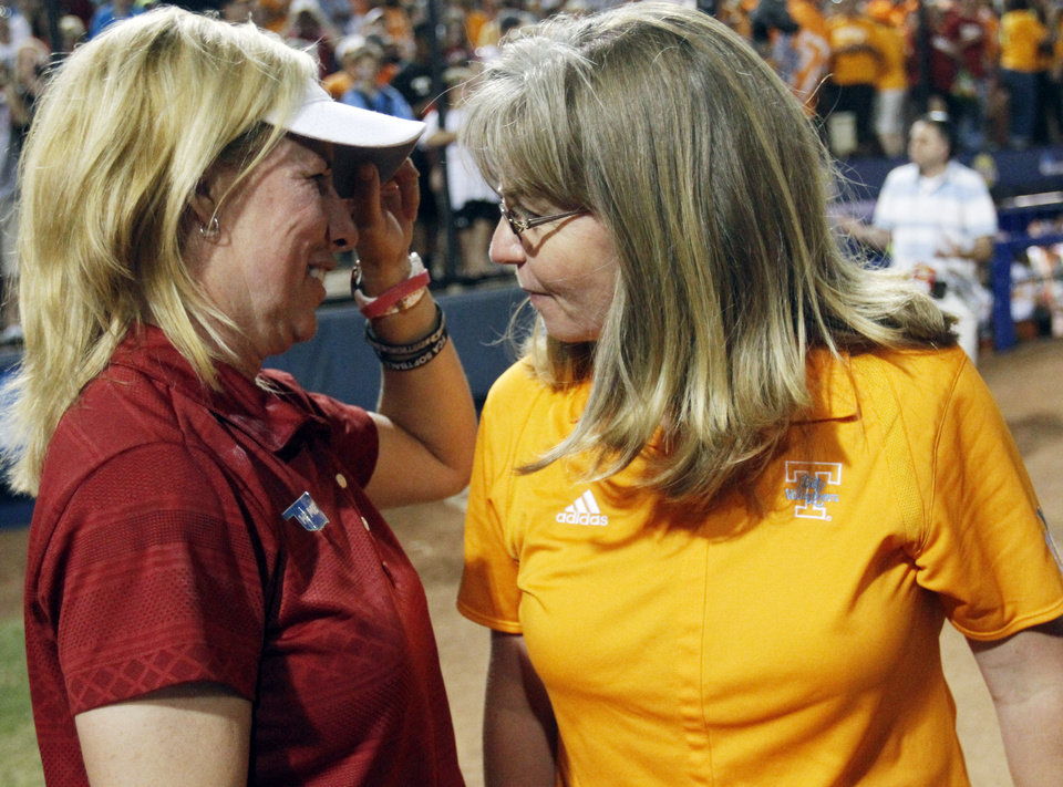 Oklahoma coach Patty Gasso is congratulated by Tennessee co-head coach Karen Weekly after Oklahoma defeated Tennessee 4-0 on June 4, 2013 to win the NCAA championship. Photo by KT KING, The Oklahoman