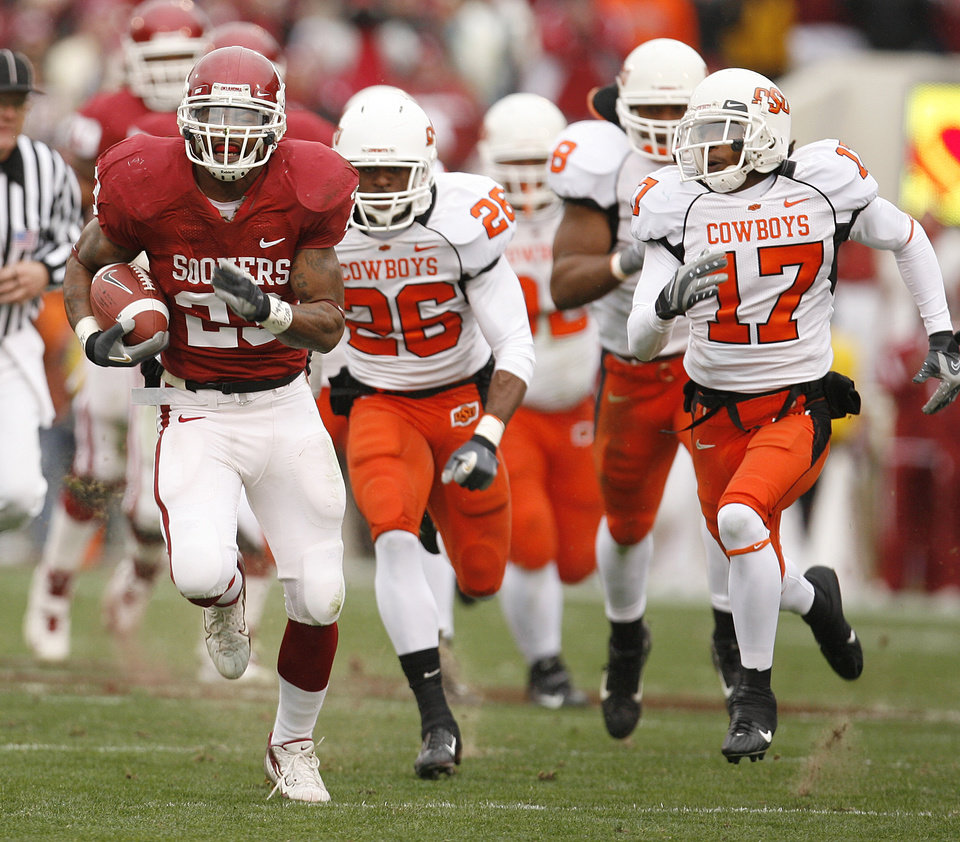 Photo - Oklahoma's Allen Patrick (23) takes the ball up field past the Oklahoma State defense during the first half of the college football game between the University of Oklahoma Sooners (OU) and the Oklahoma State University Cowboys (OSU) at the Gaylord Family-Memorial Stadium on Saturday, Nov. 24, 2007, in Norman, Okla.  Photo By Bryan Terry, The Oklahoman