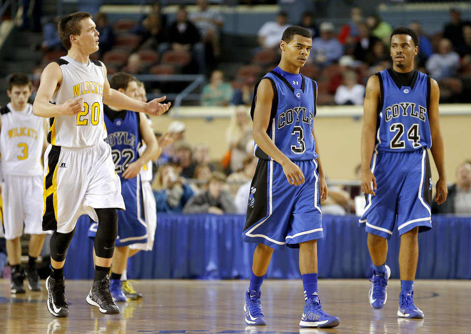 Photo - Arnett's Tyler Tune, left, celebrates beside Coyle's Fidel Simpson and Jakobi Brown, at right,  during the Class B boys state championship game between Coyle and Arnett in the State Fair Arena at State Fair Park in Oklahoma City, Saturday, March 2, 2013. Photo by Bryan Terry, The Oklahoman