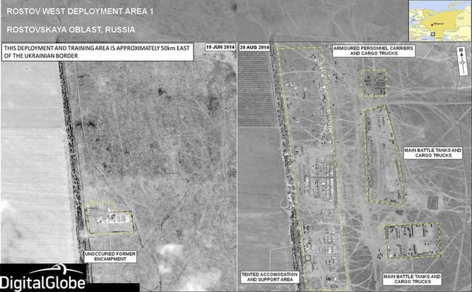 Photo - This combination of June 19, 2014 and Aug. 20, 2014 satellite images made by DigitalGlobe and annotated by NATO shows what the military alliance says are battle tanks, armored personnel carriers and tented accommodations in an area that was mostly empty two months earlier in the Rostov area of Russia near the border with eastern Ukraine. On Thursday, Aug. 28, 2014, senior NATO official, Brig. Gen. Nico Tak, said,