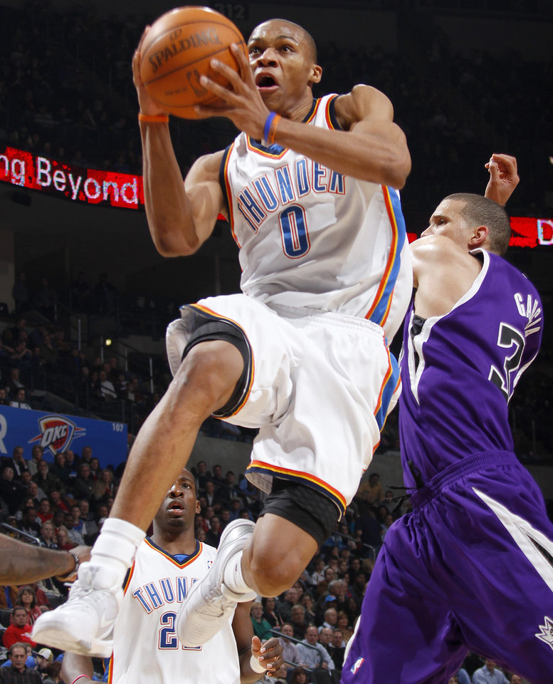 Photo - Oklahoma City's Russell Westbrook drives past Sacramento's Francisco Garcia during the NBA basketball game between the Oklahoma City Thunder and the Sacramento Kings at the Ford Center in Oklahoma City, Tuesday, March 2, 2010.  Photo by Bryan Terry, The Oklahoman