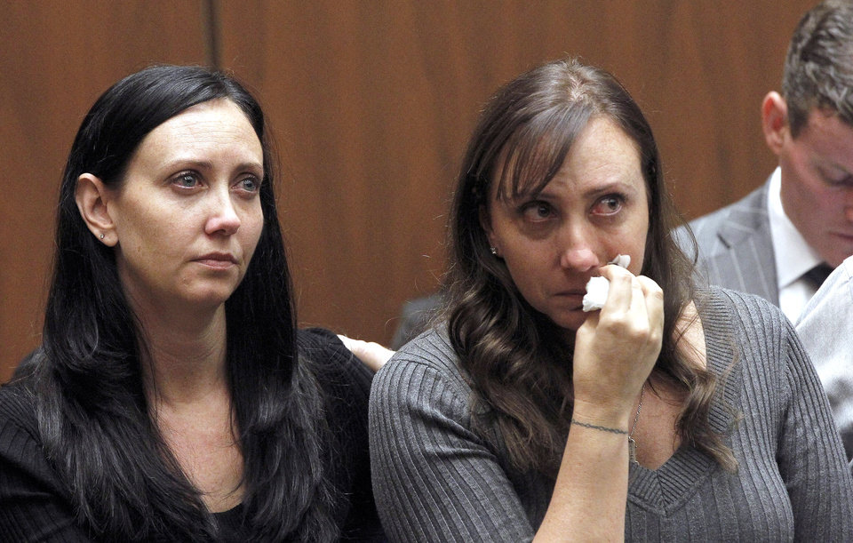 Photo - Evin Collins, and Bonnie Stow, sisters of beating victim Bryan Stow are shown during a hearing Thursday Feb. 20, 2014 in Los Angeles. Two men, Marvin Norwood, and Louie Sanchez  pleaded guilty Thursday to a 2011 beating at Dodger Stadium that left San Francisco Giants fan Stow brain damaged and disabled. The pair were  immediately sentenced by an angry judge who called them cowards and the sort of people that sports fans fear when they go to games.(AP Photo/Nick Ut )