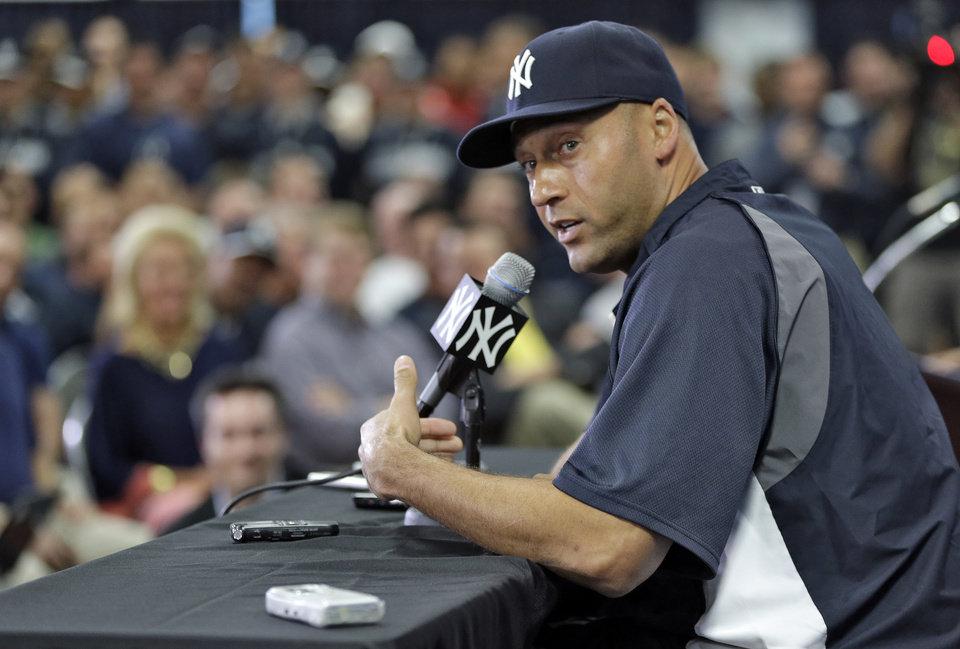 Photo - New York Yankees shortstop Derek Jeter gestures during a news conference Wednesday, Feb. 19, 2014, in Tampa, Fla. Jeter has announced he will retire at the end of the 2014 season. (AP Photo/Chris O'Meara)