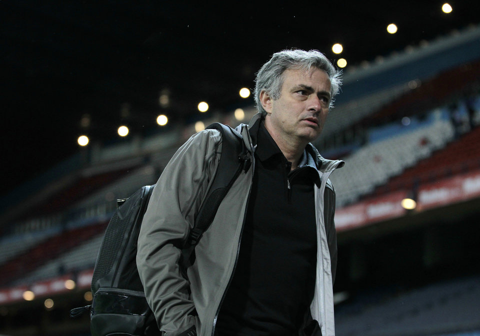 Photo - FILE - In this Saturday, April 27, 2013 file photo Real Madrid's coach Jose Mourinho from Portugal leaves the stadium following a Spanish La Liga soccer match against Atletico de Madrid at the Vicente Calderon stadium in Madrid, Spain. Real Madrid says Monday May 20, 2013, coach Jose Mourinho will leave at end of season. (AP Photo/Andres Kudacki, File)