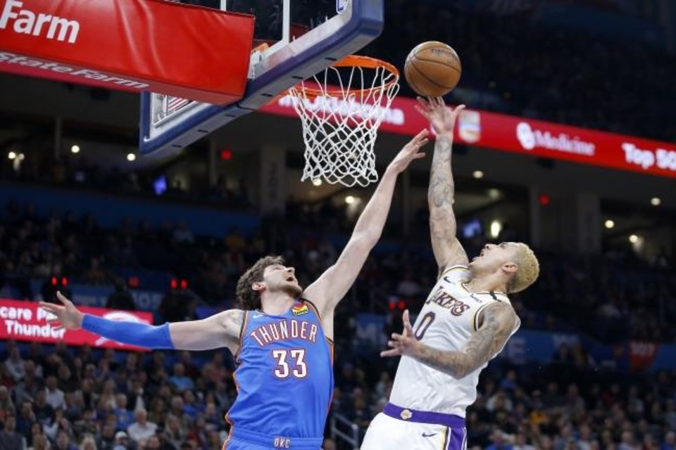 Photo -  Thunder center Mike Muscala defends Lakers forward Kyle Kuzma. The Lakers took three of four games from the Thunder last season. [Bryan Terry/The Oklahoman]