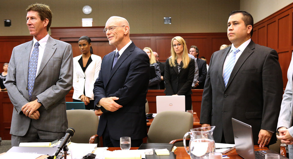 George Zimmerman, right, stands with his attorneys, Mark O'Mara, left, and Don West, center, as the jury enters the courtroom during the 16th day of his trial in Seminole circuit court, in Sanford, Fla., Monday, July  1, 2013.  Zimmerman has been charged with second-degree murder for the 2012 shooting death of Trayvon Martin.(AP Photo/Orlando Sentinel, Joe Burbank, Pool)