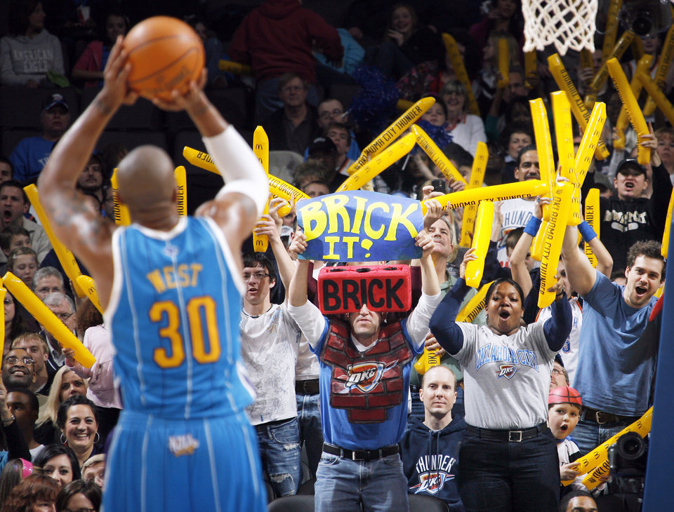 Photo - Oklahoma City fans try to distract New Orleans' David West as he takes a foul shot during action on Wednesday. Oklahoma City won 98-83.  Photo by Nate Billings, The Oklahoman