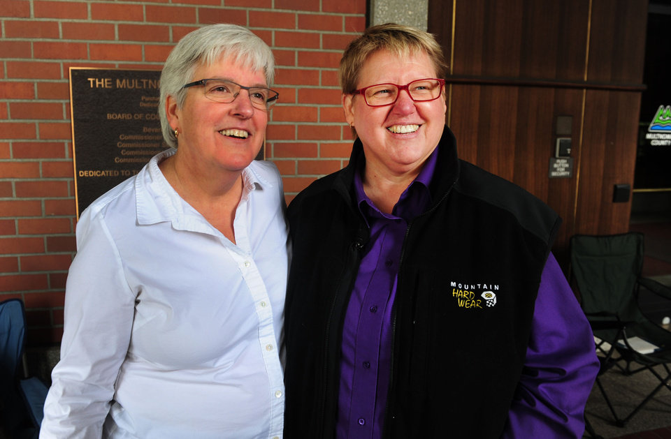 Photo - Deana Geiger, left, and Janine Nelson are interviewed in front of the Multnomah County Recorder's building in Portland, Ore. on Monday, May. 19, 2014. Geiger and Nelson are the plaintiffs in the Marriage Equality case. A ruling in that case is expected on Monday. (AP Photo/Steve Dykes)