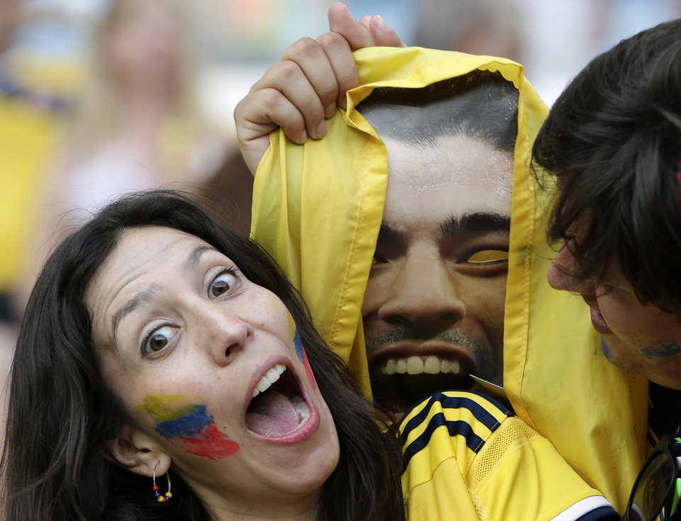 Photo - Colombian supporters hold up a photo of Uruguay's Luis Suarez before the World Cup round of 16 soccer match between Colombia and Uruguay at the Maracana Stadium in Rio de Janeiro, Brazil, Saturday, June 28, 2014. (AP Photo/Marcio Jose Sanchez)