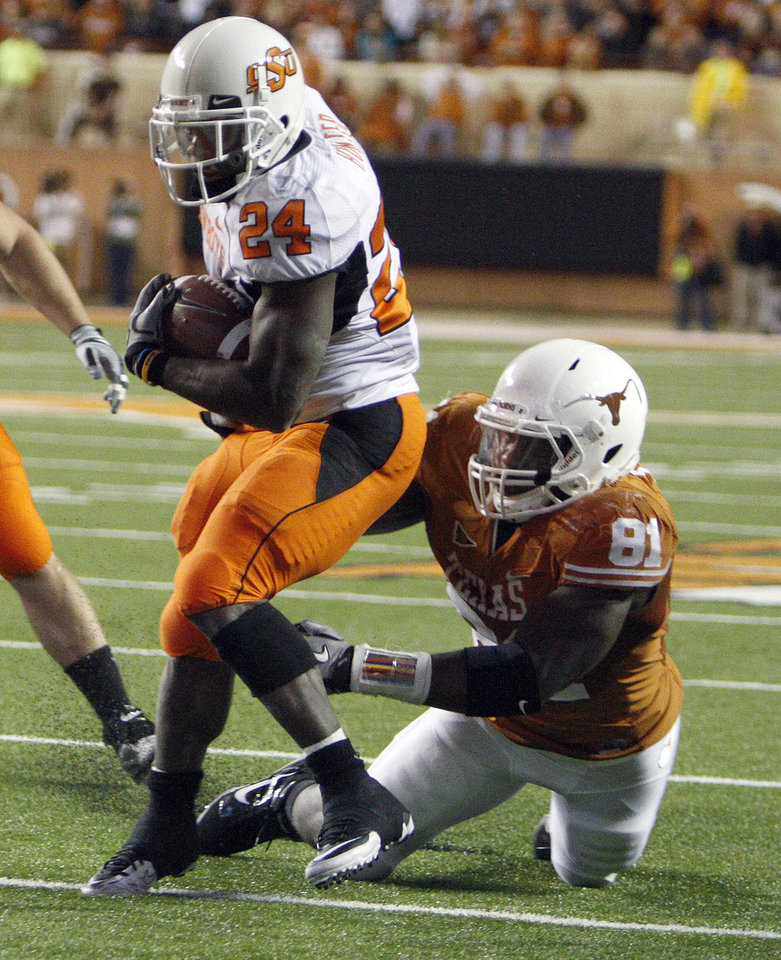 Photo - Oklahoma State's Kendall Hunter (24) gets loose from Texas' Sam Acho (81) on his way to score a touchdown during the college football game between the Oklahoma State University Cowboys (OSU) and the University of Texas Longhorns (UT) at Darrell K Royal-Texas Memorial Stadium in Austin, Texas, Saturday, November 13, 2010. Photo by Sarah Phipps, The Oklahoman
