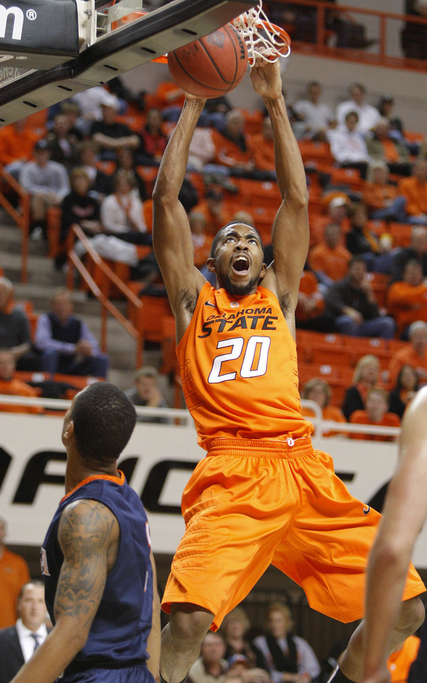 Oklahoma State's Michael Cobbins (20) dunks the ball during an NCAA college basketball game between the Oklahoma State University Cowboys (OSU) and the University of Texas-San Antonio Roadrunners at Gallagher-Iba Arena in Stillwater, Okla., Wednesday, Nov. 16, 2011. Photo by Bryan Terry, The Oklahoman