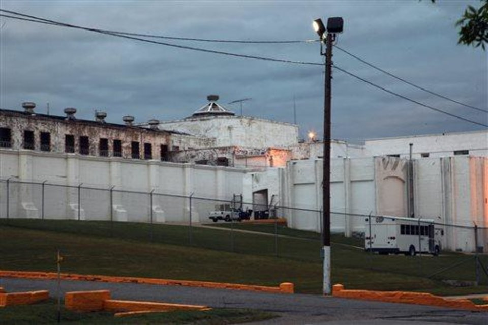 Photo - This April 29, 2014 photo shows the Oklahoma State Penitentiary in McAlester, Okla. after Robert Patton stopped the execution of Clayton Lockett. Lockett died 43 minutes after his execution began Tuesday night as Oklahoma used a new drug combination for the first time in the state. Autopsy results are pending but state prison officials say Lockett apparently suffered a massive heart attack. (AP Photo/Tulsa World, John Clanton)  KOTV OUT; KJRH OUT; KTUL OUT; KOKI OUT; KQCW OUT; KDOR OUT; TULSA OUT; TULSA ONLINE OUT