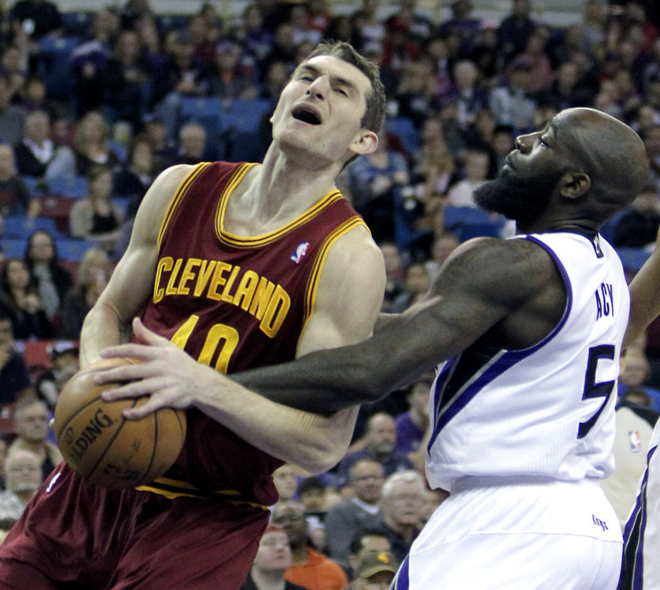 Cleveland Cavaliers center Tyler Zeller, left, is fouled by Sacramento Kings forward Quincy Acy during the first quarter of an NBA basketball game in Sacramento, Calif.,  Sunday, Jan. 12, 2014.  (AP Photo/Rich Pedroncelli)