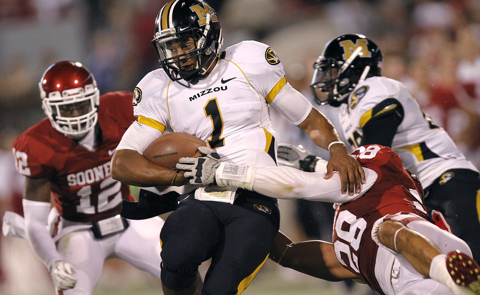 Photo - Oklahoma's Travis Lewis (28) stops Missouri's James Franklin (1) during the college football game between the University of Oklahoma Sooners (OU) and the University of Missouri Tigers (MU) at the Gaylord Family-Memorial Stadium on Saturday, Sept. 24, 2011, in Norman, Okla. Photo by Chris Landsberger, The Oklahoman