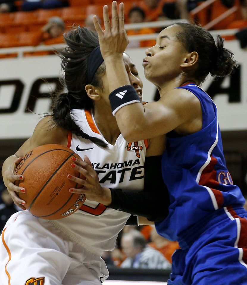 Photo - Oklahoma State's Tiffany Bias (3) runs into Kansas' Angel Goodrich (3) during a women's college basketball game between Oklahoma State University (OSU) and Kansas at Gallagher-Iba Arena in Stillwater, Okla., Tuesday, Jan. 8, 2013. Oklahoma State won 76-59. Photo by Bryan Terry, The Oklahoman