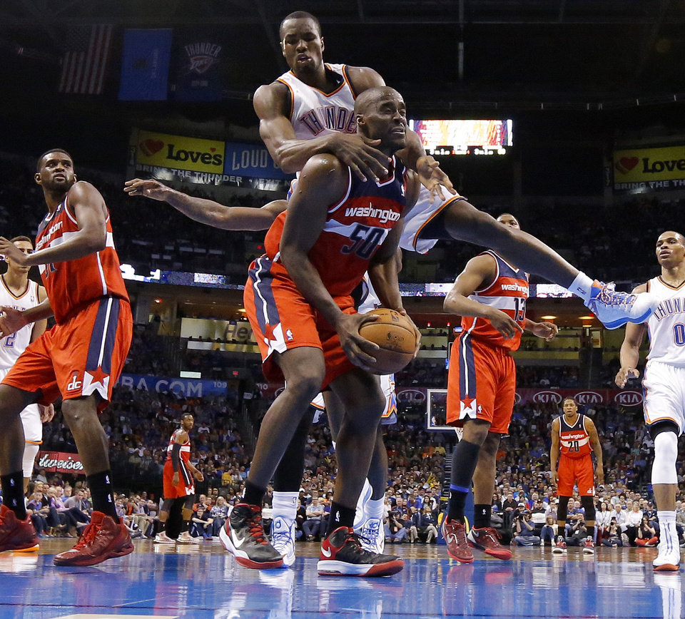 Oklahoma City\'s Serge Ibaka (9) fouls Washington\'s Emeka Okafor (50) during an NBA basketball game between the Oklahoma City Thunder and the Washington Wizards at Chesapeake Energy Arena in Oklahoma City, Wednesday, March 19, 2013. Oklahoma City won 103-80. Photo by Bryan Terry, The Oklahoman