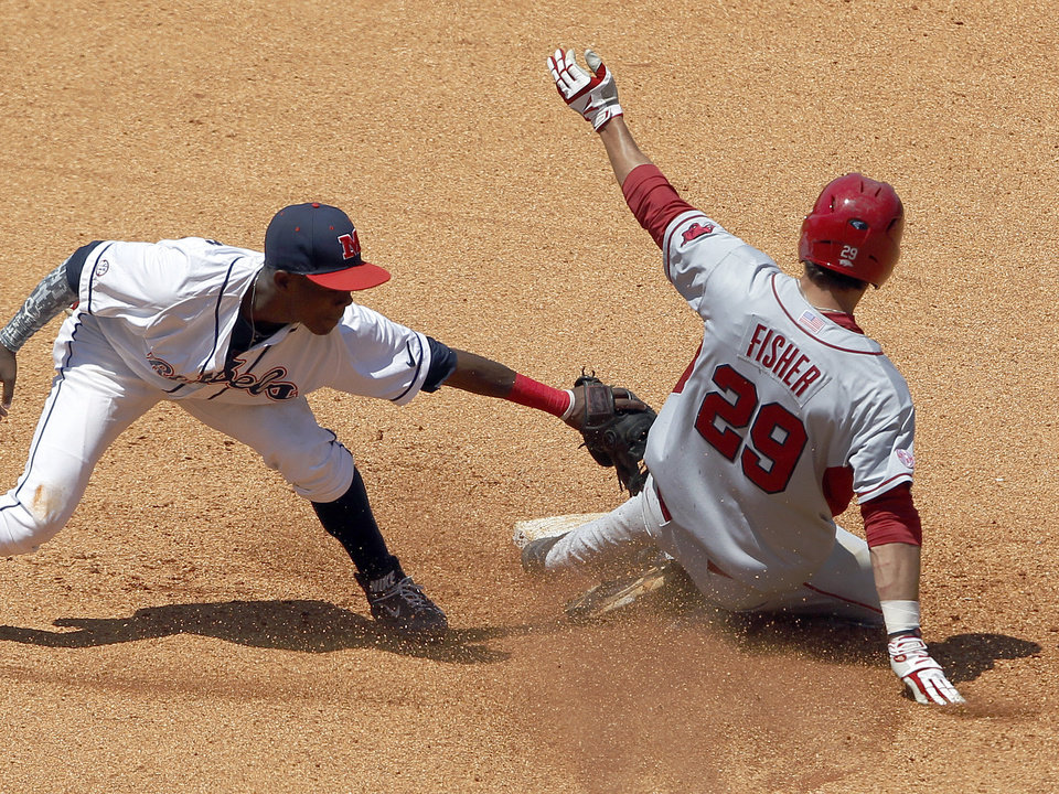 Photo - Arkansas' Eric Fisher (29) slides safe into second base under the tag of Mississippi's Errol Robinson (6) during the 6th inning at the Southeastern Conference NCAA college baseball tournament on Wednesday, May 21, 2014, in Hoover, Ala. (AP Photo/Butch Dill)